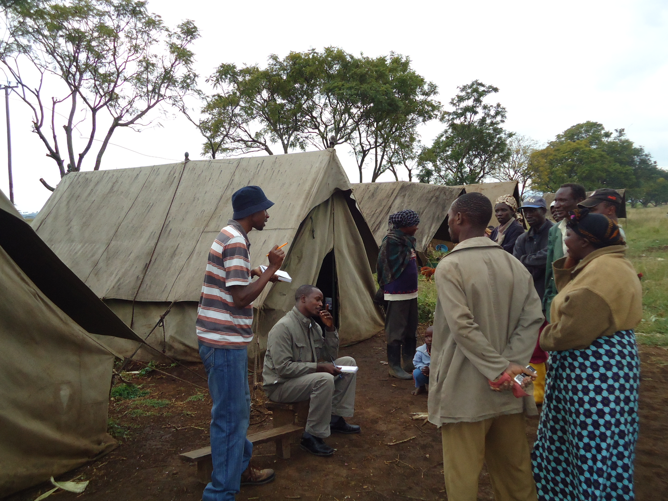 KNCHR Officer with a section of IDPs at GIWA farm