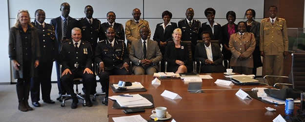 KNCHR Commission secretary Ms Patricia Nyaundi (seated 2nd from left on the front  row) in a group photo where she attended a training workshop for Trainers of Trainers in Toronto, Canada on building capacity of police officers on how to handle  defilement cases