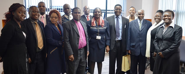 Zimbabwe Heads of Christian Denomination Delegation led by Bishop Ishmael Mukuwanda (in purple) are welcomed by KNCHR Commissioner Suzzane Shatikha(in a red scurf) for a discussion on reparation processes. Looking on are other KNCHR Heads of Departments.