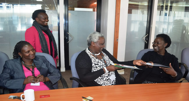 From Right:Healthstrat Director Prof Sylvia Ojoo exchanges the signed MOU with KNCHR Chair Ms Kagwiria Mbogori. Looking on is KNCHR Commissioner Ms Chivusia and standing KNCHR CEO Mrs Nyaundi